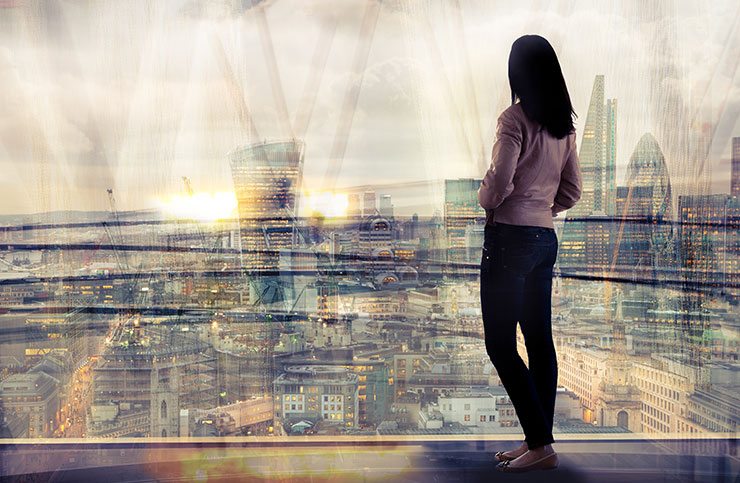 Woman looking over the city at sunset: 2020 recruiting trends