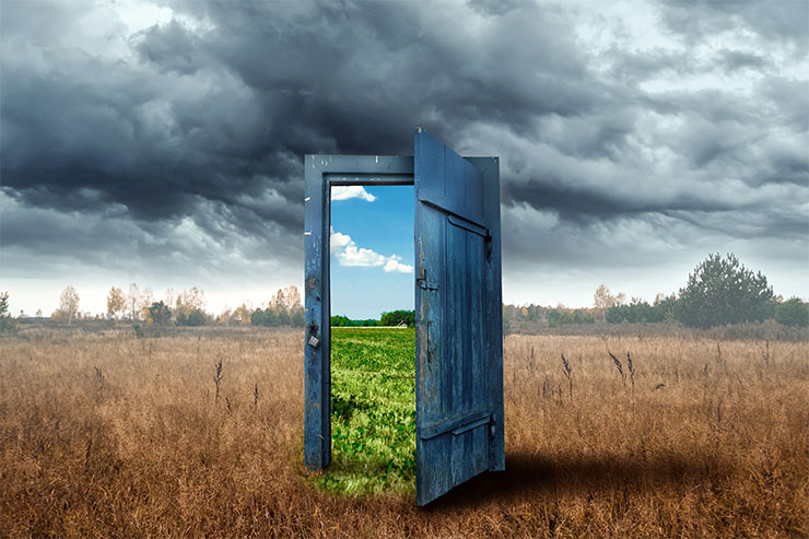 How to change careers: Old wooden door, blue colour, in the box. Transition to a different climate.