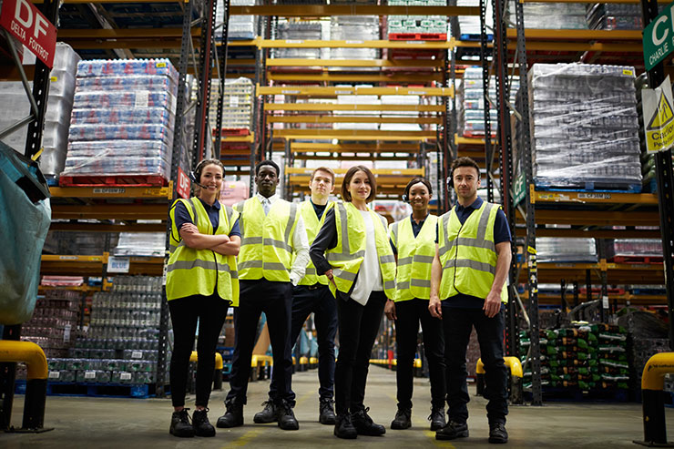 Where to recruit warehouse workers: Group portrait of staff at distribution warehouse