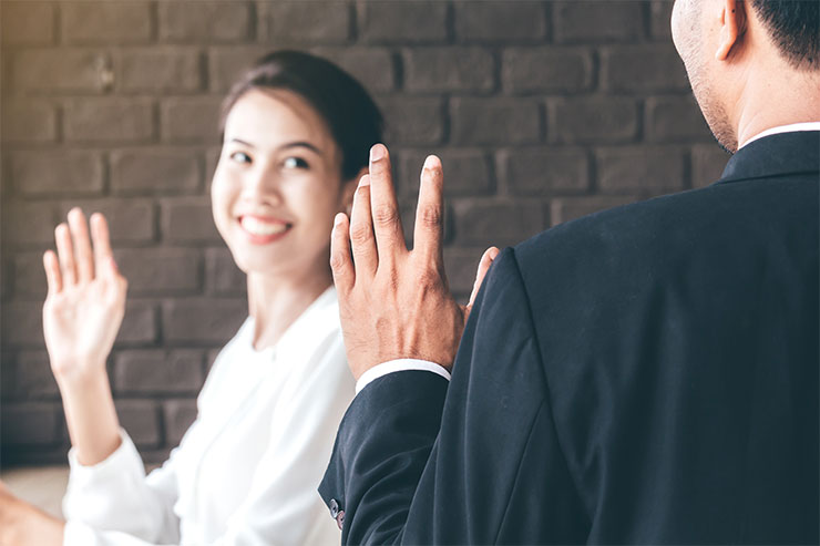 Conducting an exit interview: woman waving