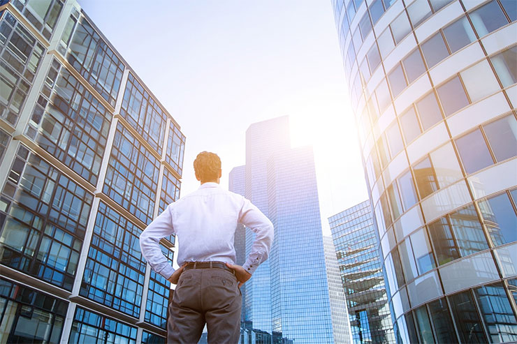 How to change careers: man looking at office buildings