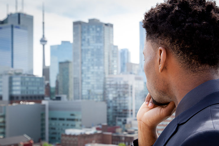 Finding a job in Canada: businessman looking out the window