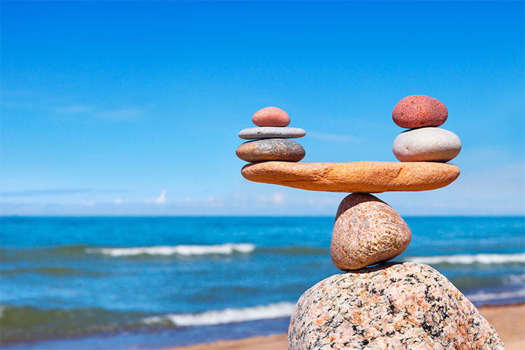 Work/life balance: balance stones against the sea