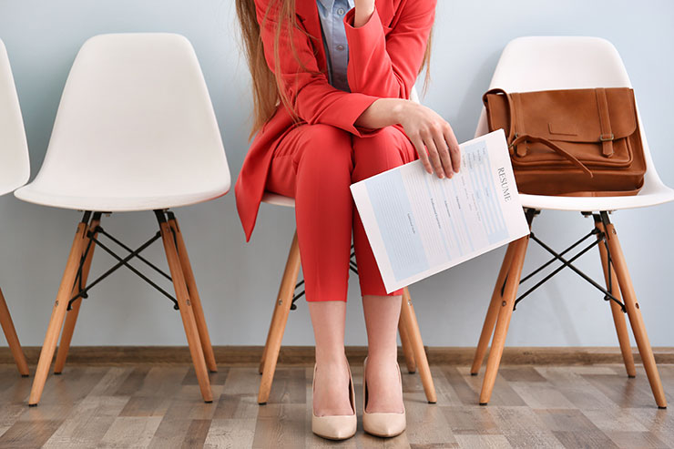 Person in red suit waiting for interview